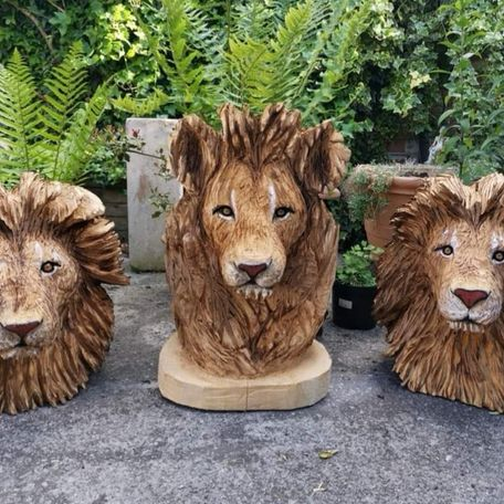 Three lions, life size heads, with paint highlights