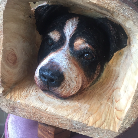 mixed breed carving with painted highlights